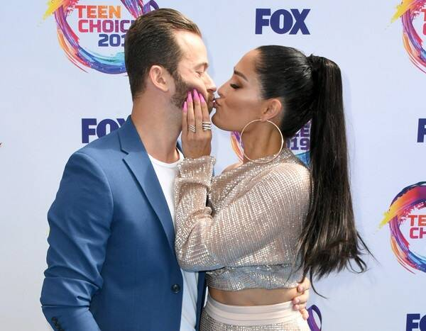 Nikki Bella And Artem Chigvintsev Adorably Pack  On The PDA Carpet At Teen Choice Awards