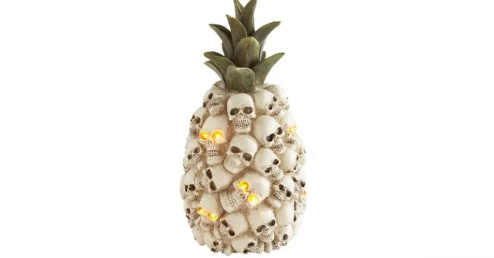 throw a halloween luau with this creepy light-up pineapple of skulls