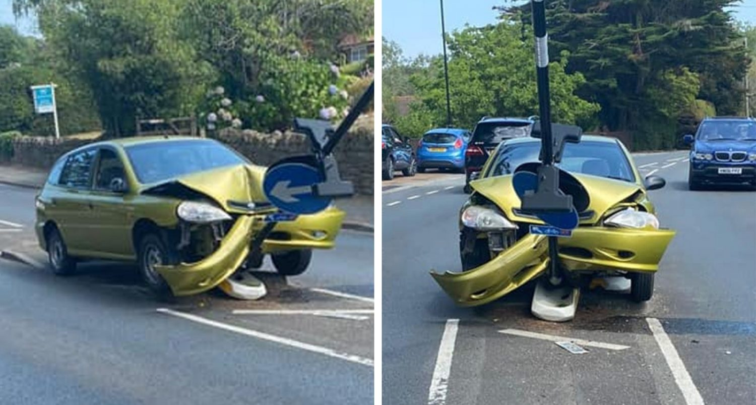 Driver Crashes Into Sign While Trying To Get Rid Of A Spider In His Car