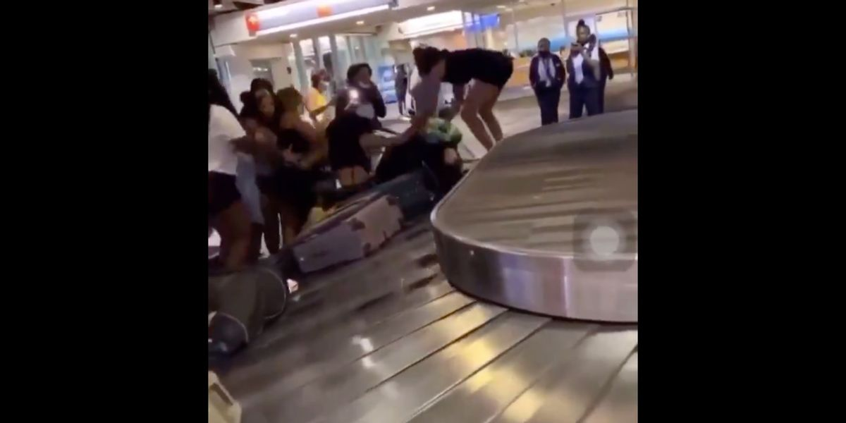 Viral video captures vicious mob brutally beating couple at the airport while security stands by filming