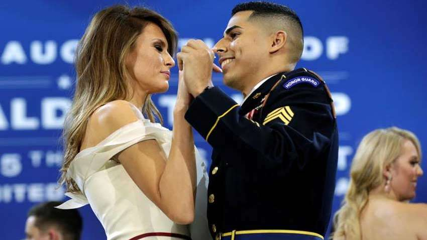 melania trump photo arm-in-arm with a soldier under umbrella goes viral even as donald trump divorce rumors rage