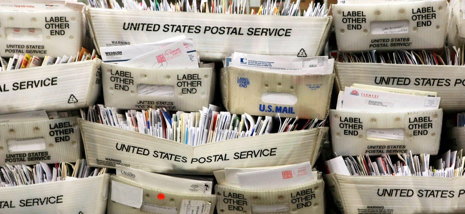 usps worker arrested at canadian border with bin of mail, undelivered ballots