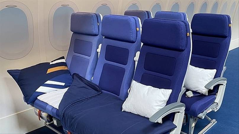 lufthansa allowing passengers to buy an entire aeroplane row to sleep across