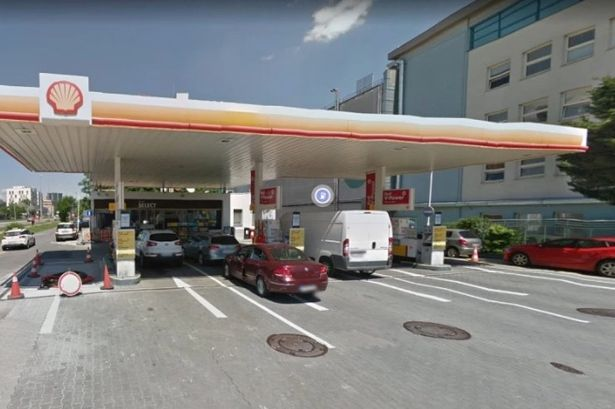 woman kept robber at petrol station for police to arrive by 'performing sex act on him'