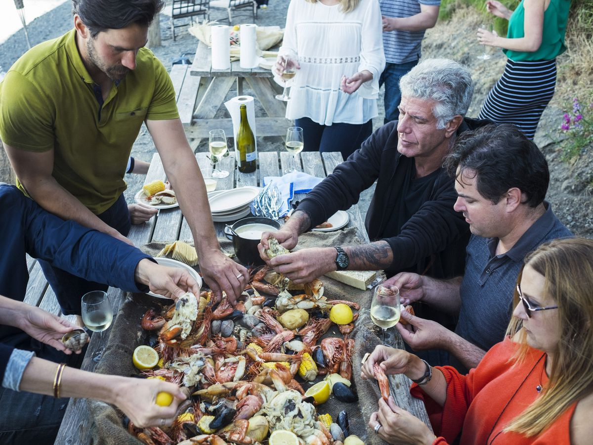 anthony bourdain knew a shared meal could turn stranger to friend
