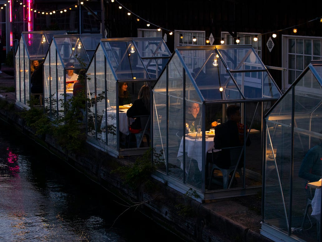 amsterdam restaurant builds individual greenhouses for social distancing while dining