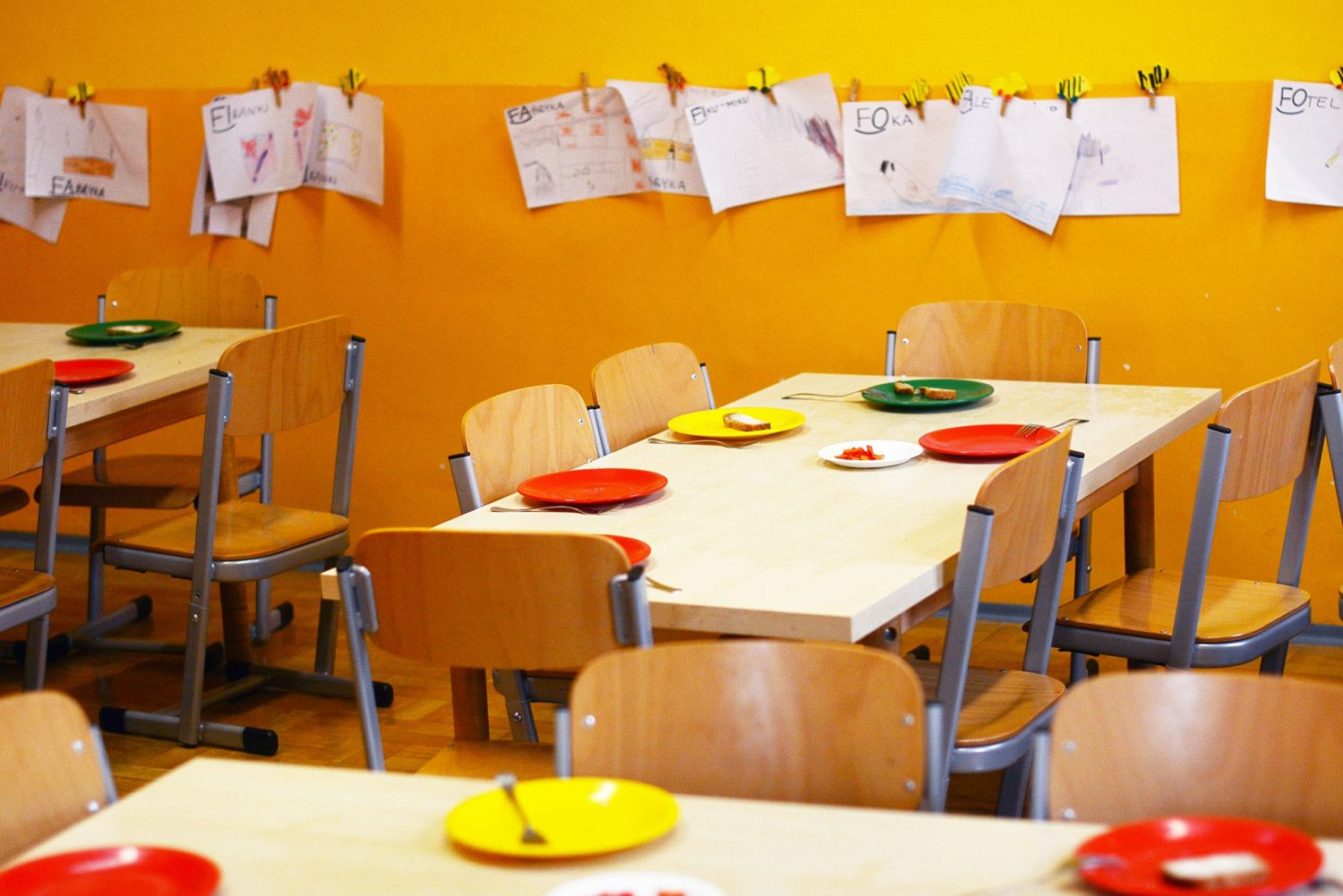 photo surfaces of black preschool students waiting for food while white classmates eat